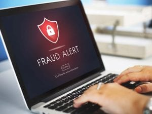 computer showing fraud alert and lack of privacy & security