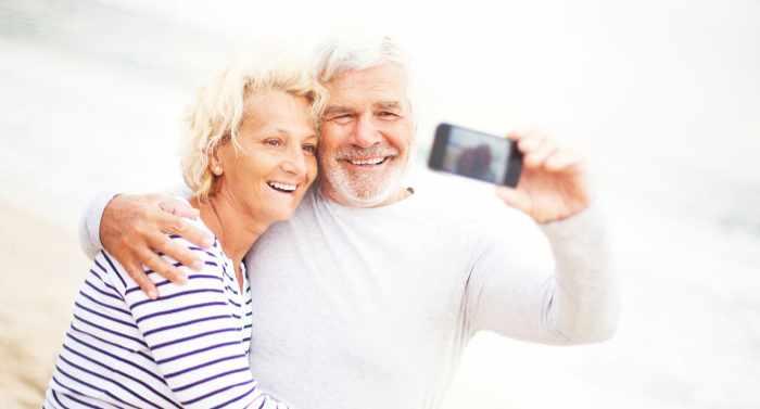 retired couple taking a selfie