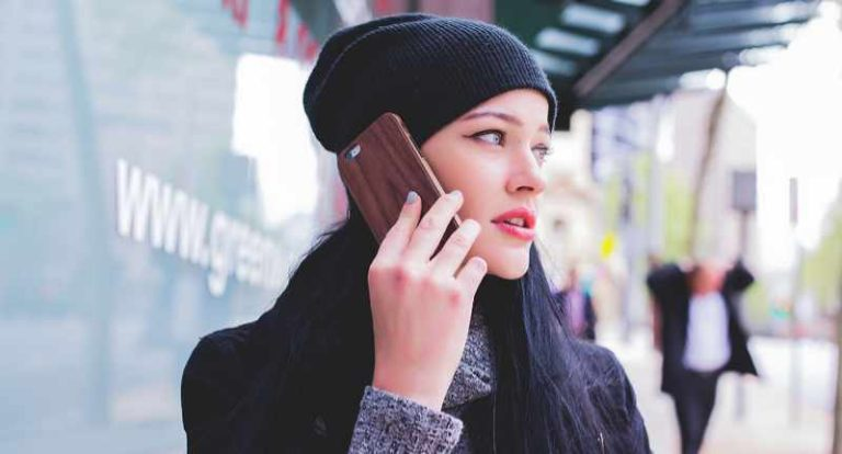 woman on cell phone calling about overdraft protection personal lending services